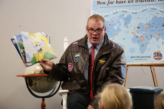 """County Mayor Glenn Jacobs showed up in full leather flight jacket and sunglasses for the """"Take a Trip Around the World"""" theme at the Read City USA launch at Burlington Branch Library on Jan. 13, 2020. The children got pilot hats and sunglasses, too."""