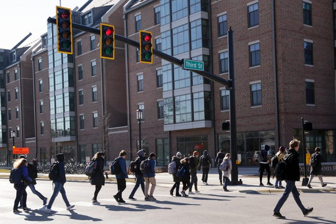 Pedestians walk along Third Street on Purdue University's campus, Thursday, Jan. 16, 2020 in West Lafayette. Purdue and the city of West Lafayette announced plans to close Third Street from University Street to Martin Jischke Drive to all vehicular traffic.