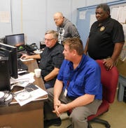 St. Landry Parish computer center employees work with a consulting firm to examine the damage caused by Wednesday morning's cyber threat on the district's computer system. Charles Morrison, a consultant with Cohesive Connections and district computer employees John Kittle (background) and Edmond Reed work with Morrison on the problem Thursday morning at the computer center.