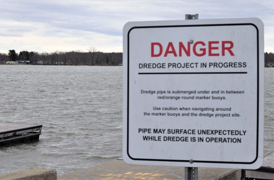 A sign warns boaters about the ongoing dredging project at Buckeye Lake. The project removes silt built up on the bottom of the lake in an effort to improve water quality.
