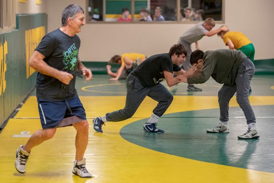 """Floyd Central sibling wrestlers Codei Khawaja, from right, and Dayeen Khawaja, practice before a match as their grandfather, grandfather, Momir Petkovic, looks on. Petkovic won in the 1976 Olympics for wrestling at 180.5 pounds in Montreal, Canada, with his older brother, senior . The two brothers began wrestling when they were around 4 or 5 years old in the Olympic Training Center. """"Our grandpa always taught us lessons, not just about wrestling, but about life,"""" Dayeen said. """"I just want them to love it and enjoy it and learn all the benefits they can from this beautiful sport,"""" Petkovic said. """"Medals come and go, but this stays with you the rest of your life."""" Jan. 16, 2020"""