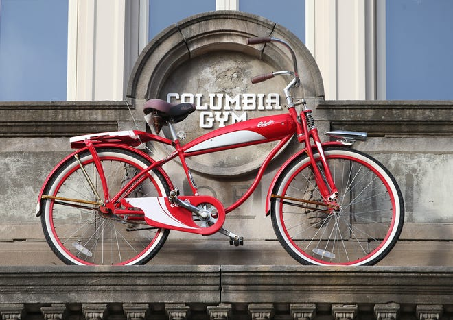 A red bike sits atop the entrance to Columbia Gym as a reminder of the role the gym played in the early boxing career of Muhammad Ali.
