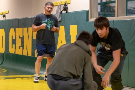"""Floyd Central sibling wrestlers Dayeen Khawaja, from right, and Codei Khawaja, practice before a match as their grandfather, grandfather, Momir Petkovic, looks on. Petkovic won in the 1976 Olympics for wrestling at 180.5 pounds in Montreal, Canada, with his older brother, senior . The two brothers began wrestling when they were around 4 or 5 years old in the Olympic Training Center. """"Our grandpa always taught us lessons, not just about wrestling, but about life,"""" Dayeen said. """"I just want them to love it and enjoy it and learn all the benefits they can from this beautiful sport,"""" Petkovic said. """"Medals come and go, but this stays with you the rest of your life."""" Jan. 16, 2020"""
