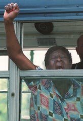 Mattie Jones yelled to supporters as she was taken to jail for trespassing at the Valhalla Golf Course in 1996.