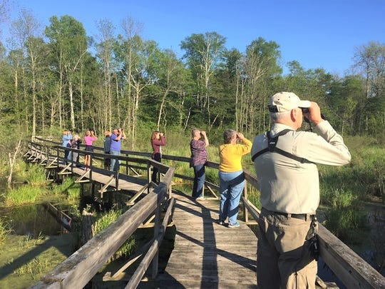Birdwatchers at Woodland Dunes in Two Rivers.