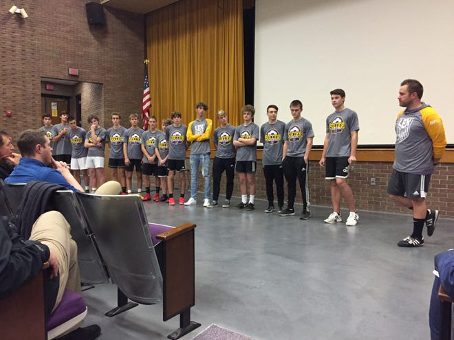 Members of the Lexington boys soccer team attend Wednesday's school board meeting to receive recognition for making the state championship game in Division II.