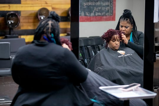 Salon owner Takeisha Berry-Brooks retightens Ashley Gates' Sisterlocks on Thursday, Jan. 16, 2020, at A Natural Affair salon in Memphis. Gates has been coming to Berry-Brooks for her natural hair care for ten years.