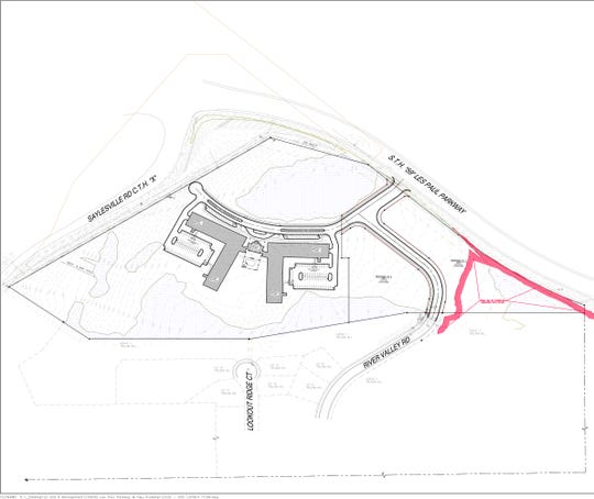 The preliminary site plan for Parkway LLC's River Valley Apartments shows L-shaped apartment buildings, plus a pair of outlots that could be used for commercial development. The 30-acre parcel is located on the southside of the junction of Saylesville Road and Les Paul Parkway.