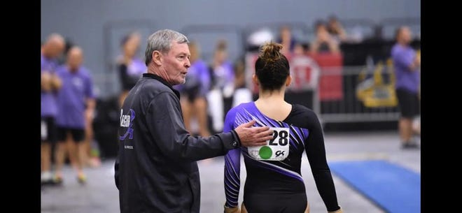 Greg LaFleur, a longtime gymnastics coach who owned LaFleur's Gymnastics for more than 30 years, gives words of encouragement to Maddy Langkamp, now a gymnast at Iowa State University. LaFleur died Jan. 10.
