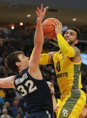 Marquette guard Markus Howard goes up for a shot against Xavier forward Zach Freemantle during the first half.