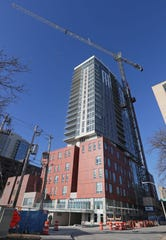 Construction continues on the Saint John's on the Lake senior housing tower on Milwaukee's east side. The city is being sued for claiming the new tower should pay property taxes despite being operated by a nonprofit group.