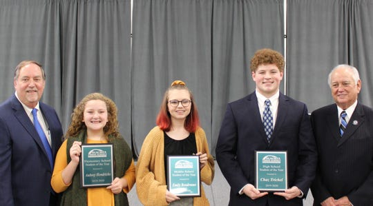Ouachita Schools Superintendent Don Coker (far left) and Ouachita Parish School Board President Jerry Hicks congratulate the district Students of the Year. They are (from left) Aubrey Hendricksof Swartz UpperElementary,Emily Boudreaux ofEast Ouachita Middle andChaz Trichel of West Monroe High.