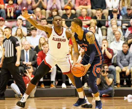 Alabama forward Javian Davis (0) plays defense against Auburn guard Samir Doughty (10) on Wednesday, Jan. 15, 2020.