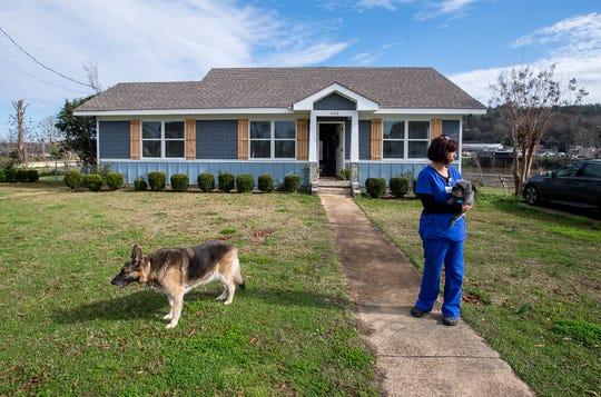 Janice Vance stands in front of her rebuilt home in Wetumpka, Ala., on Thursday January 16, 2020. The house was severely damaged during the January 2019 tornado that hit Wetumpka.