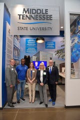 MTSU representatives are shown Tuesday, Jan. 14, at the grand opening of the new JA Finance Park on Powell Place in Nashville, Tenn. Pictured, from left, are Joe Bales, vice president for university advancement; MTSU Trustee and Vice Chairman Darrell Freeman Sr.; Sherry Wiser George, graphic artist with MTSU Creative Marketing Solutions; MTSU alumna, trustee and Junior Achievement of Middle Tennessee board member Pam Wright; and Andrew Oppmann, vice president for marketing and communications. The new park by Junior Achievement of Middle Tennessee provides a real-world simulation for students to learn how their financial decisions regarding higher education, health care and other areas affect their personal budgets. Wright funded an MTSU-branded room in the park that features popular university programs.