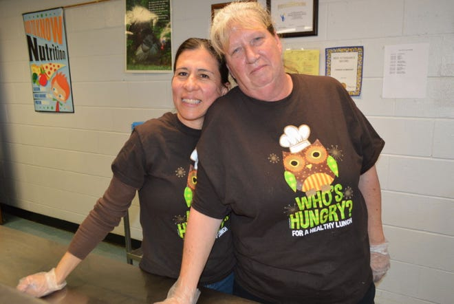The late Franklin Special School District food program director Rebecca Lounsberry (right) was posthumously honored by the district naming its summer feeding program after her. Lounsberry is pictured with Lucy Clavijo Ayda, Poplar Grove School Café assistant manager.