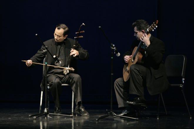 Dr. Ming Wang, (left) plays erhu with guitarist Carlos Enrique.