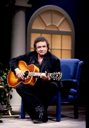 """Country singer Johnny Cash performs on the """"Crook and Chase"""" show in 1990."""