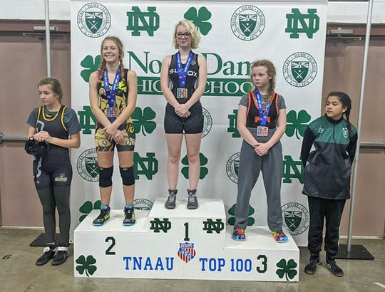 Fairview Youth Wrestling's MeKenzie Bennett stands in second place on the podium at the Chattanooga Top 100 Jan. 11, 2020.