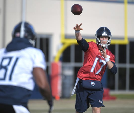 Titans quarterback Ryan Tannehill (17) throws a pass during practice at Saint Thomas Sports Park In Nashville on Thursday.