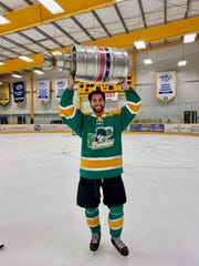 2018 Bachelorette TV show contestant Jason Tartick hoists the Stanley Keg, the championship cup for the Nashville Ford Ice Center adult rec league, Jan. 14, 2020, after his Jagr Bombers won it all