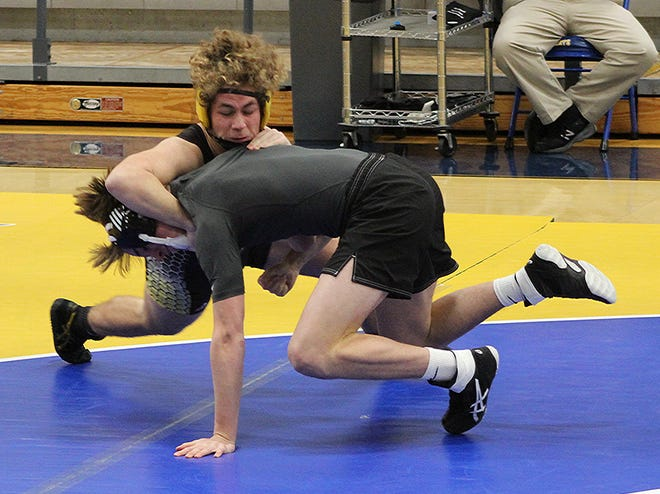 Fairview High's Brody Cox man-handling his opponent from Ensworth Tuesday night, Jan. 14, 2020, en-route to a 76-6 team victory.