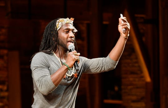 """Hamilton"" cast member Marcus John introduces students about to perform as part of the Eduham program Thursday, Jan. 16, 2020, in Nashville."