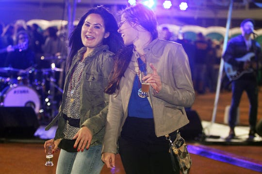 Terry Allen Williams/Special to the News-Press Katie Gold, left, and Samantha Fortune enjoy a dance as they drink beer and listen to the live music of the band Soapy Tuna during the Ballpark Festival of Beers in Fort Myers in 2016.