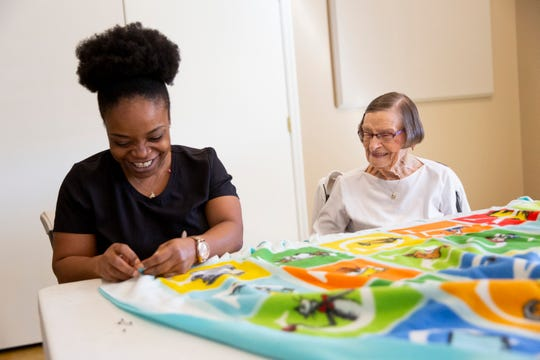 Kassandra Prudent, left, and Alta Nodland, 100, right, work on making no sew blankets for children at local hospitals at Hope Lutheran Church in Bonita Springs on Wednesday, January 15, 2020.