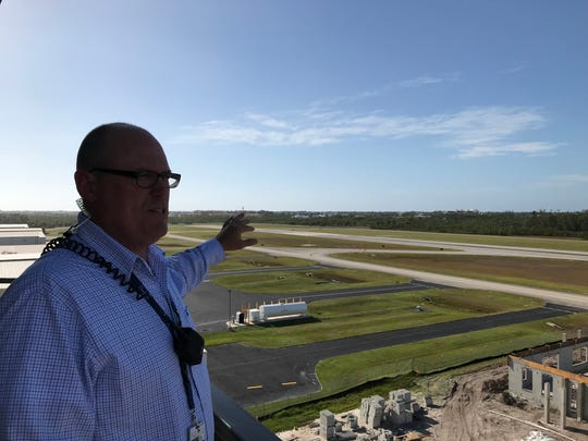 Nathan Greve, assistant manager at Naples Airport, shows off the 732 acres that includes the control tower, fuel tanks, park area and the rescue station under construction and many other components.