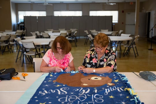 Lori Levandusky, left, and Connie Olson, right, work on making no sew blankets for children at local hospitals at Hope Lutheran Church in Bonita Springs on Wednesday, January 15, 2020.