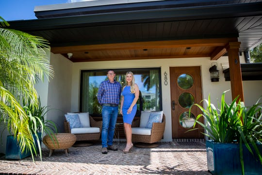 Builder Dennis Boyce, left, and designer Amanda Erwin, right, pose for a photo in front of a home they renovated on Gulf Shore Boulevard in Naples on Thursday, January 16, 2020. The house will be featured in the Naples Garden Club's House & Garden Tour.