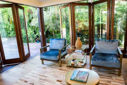 Folding doors that open from the living area out to the deck area of a renovated home on Gulf Shore Boulevard in Naples, photographed on Thursday, January 16, 2020. The house will be featured in the Naples Garden Club's House & Garden Tour.