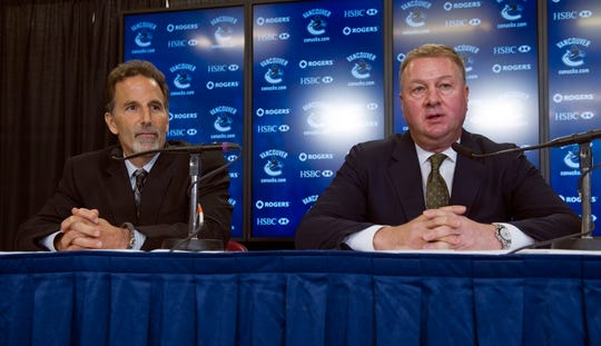 Then Vancouver Canucks general manager Mike Gillis, right, introducing head coach John Tortorella in 2013. Gillis has bold ideas and a progressive thinker may have a role with the New Jersey Devils in 2020.