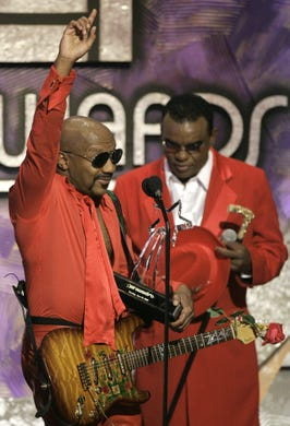Ernie Isley of the Isley Brothers throws his hand up after accepting the lifetime acheivement award during  the BET Awards as an unidentified member of the band looks on Tuesday, June 29, 2004, in Los Angeles. (AP Photo/Kevork Djansezian)