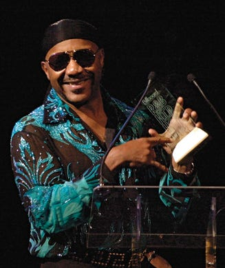 Ernie Isley of the R&B group The Isley Brothers, accepts his Founder's Award at the 2002 Billboard R&B/Hip-Hop Awards, Friday, Aug. 9, 2002,  in Miami Beach. (AP Photo/Marta Lavandier)
