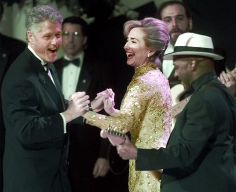 President Clinton dances with his wife Hillary Clinton to music performed by The Isley Brothers during the Ohio Ball at the National Museum in Washington, Monday, Jan. 20, 1997.  (AP Photo/Dan Loh)
