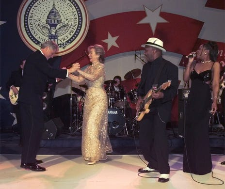 President Clinton dances with his wife Hillary Clinton to music sung by the Isley Brothers during the Ohio Ball Monday, Jan. 20, 1997, in Washington.  (AP Photo/ J. Scott Applewhite)