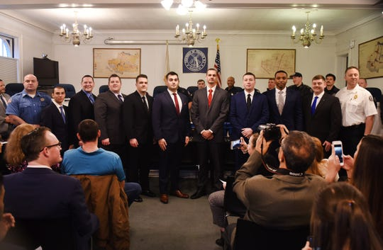 Group photo of the nine new Teaneck firefighters taken with Teaneck Fire Chief Jordan Zaretsky (shown R) following the Swearing-In Ceremony at the Council Chambers of Teaneck Municipal Building in Teaneck on 01/16/2020.