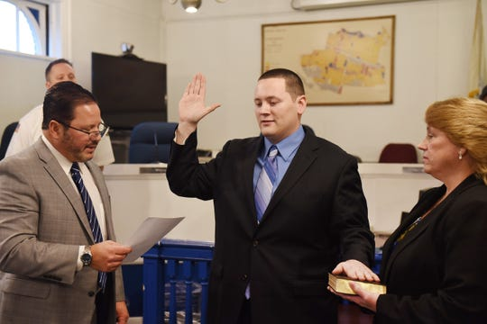 Alex C. Kneisler is sworn in by Township Manager Dean Kazinci to become a Teaneck firefighter during the Swearing-In Ceremony at the Council Chambers of Teaneck Municipal Building in Teaneck on 01/16/2020.