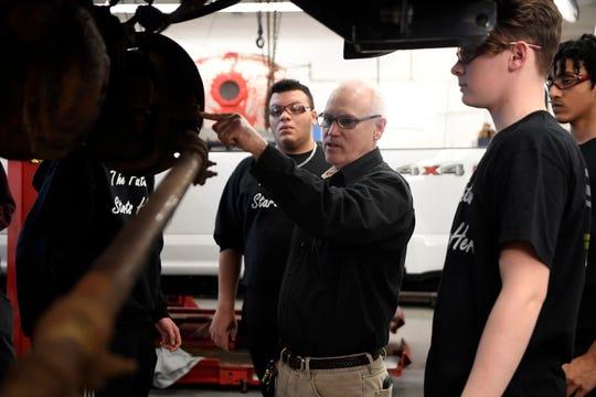 Kenneth Bergen, an automotive technology teacher at Wayne Valley, instructs students.