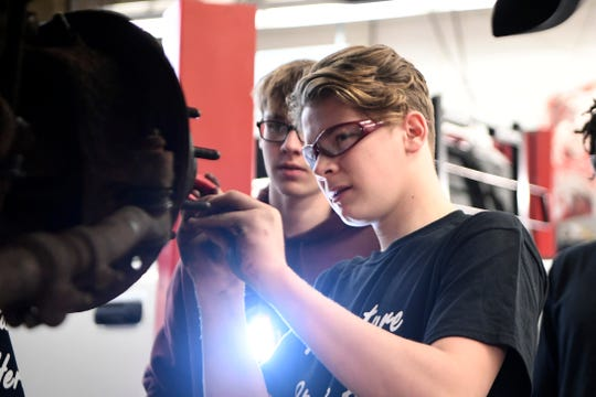 Wayne Hills High School students Ryan McVeigh, right, and James Lee fix brakes of a pickup during their automotive technology class at Wayne Valley High School on Jan. 14.