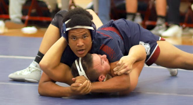 Sophomore Wildcat Anthony Carter puts the squeeze on Silver's Mason Lockett in the 170-pound match