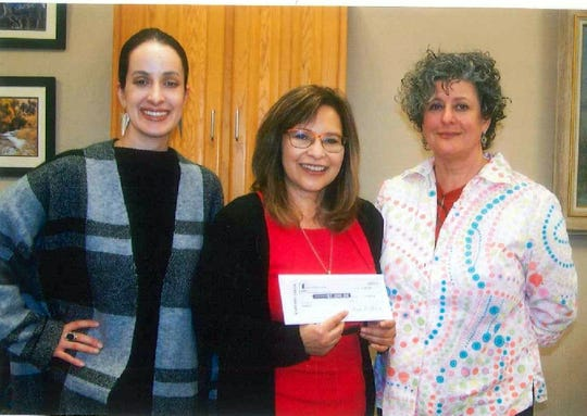 From left, Rebecca Sanchez of CHANCES, Rosa Perez of 1st NM Bank and Pauli Galin pose for the $2,000 check presentation.