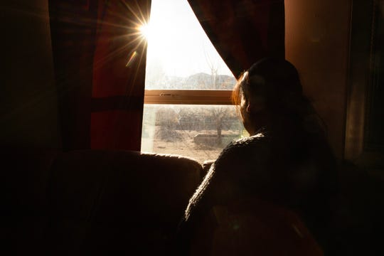 Sofia gazes out the window of her mobile home to her small yard in Chaparral — a place that she has left only rarely since moving there from Zacatecas, Mexico in 2002.
