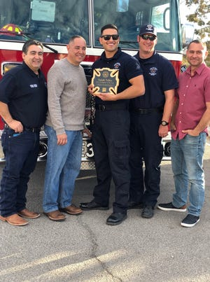 New Mexico State University alumni firefighter Isaiah Telles was recognized as NMSU's 2019 Firefighter of the Year.