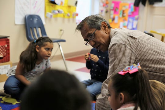 Kindergarten bilingual teacher Carlos Aceves in his classroom at Raíces del Saber Xinachtli Community School in Las Cruces on Thursday, Jan. 16, 2020.