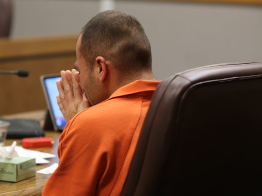 Las Cruces resident Jaime Talamantes, 30, prays in court during a pretrial detention hearing on Thursday Jan. 16, 2020.