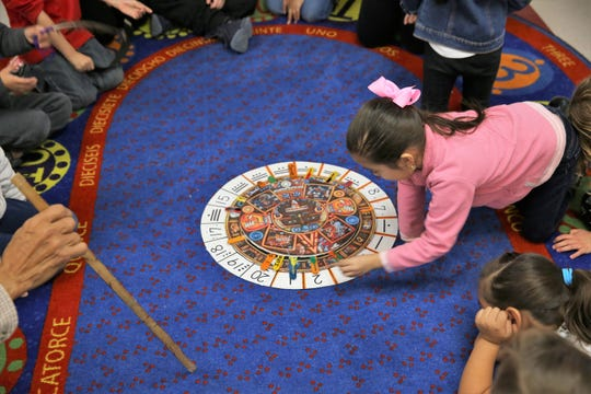 A kindergarten student at Raíces del Saber Xinachtli Community School in Las Cruces reads an Aztec calendar during class on Thursday, Jan. 16, 2020.