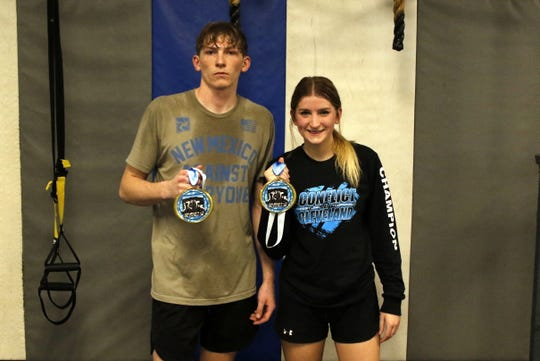 Carlsbad's Mason Box and Cady Box display their first place medals won at the 2020 Conflict at Cleveland Tournament. Mason went 5-0 and Cady went 3-0.